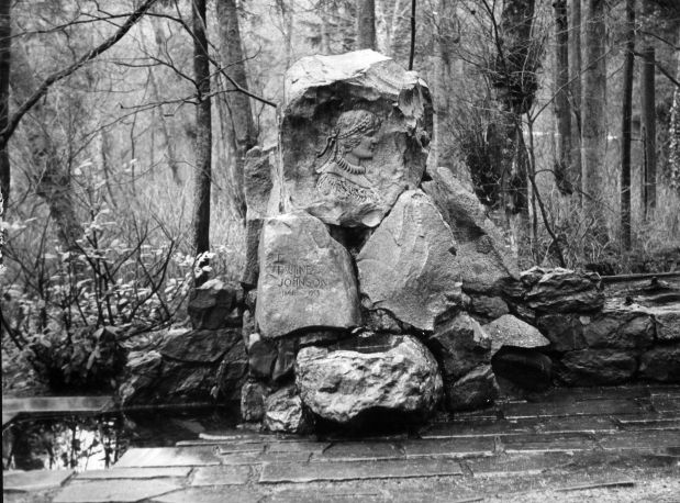 Before her death, poet Pauline Johnson requested she be buried in Stanley Park, her favourite retreat in Vancouver. Though she requested that her grave have no monument, in 1922 the Women's Canadian Club erected this large stone etched with her picture and Mohawk designs.