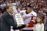Steve Yzerman accepts the Stanley Cup from NHL Commissioner Gary Bettman and hands it off to retiring coach Scotty Bowman.