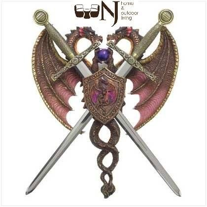 No castle is complete without a noble knightly crest! Two proud #dragons, locked in battle, intertwine to form a curvy backdrop for two shining gold-hilted removable #swords. Hang this prize with pride upon your door or wall! Polyresin with metal swords. Call For Order: 1-888-988-8258