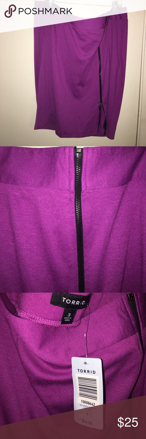 Torrid. Purple pencil skirt. Size 3X Cute purple pencil skirt with. Black zipper detail down the front. Never worn. Still has tags. Size 3X torrid Skirts Pencil