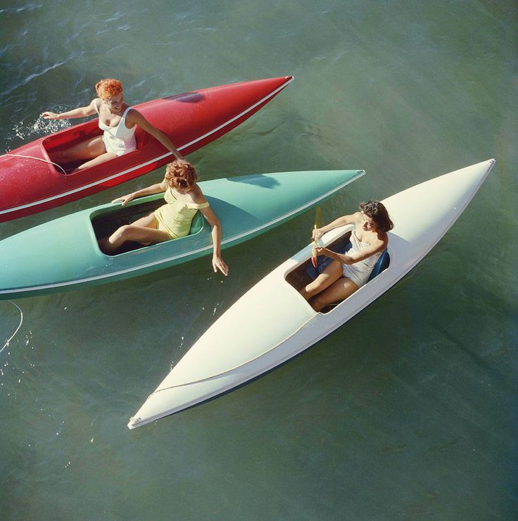 Young women canoeing on the Nevada side of Lake Tahoe, photographed by Slim Aarons in 1959.