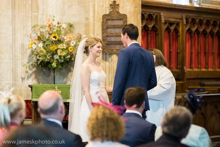 Snettisham Church Norfolk Wedding ceremony. happy couple. Norfolk coast. bride long veil.www.jameskphoto.co.uk
