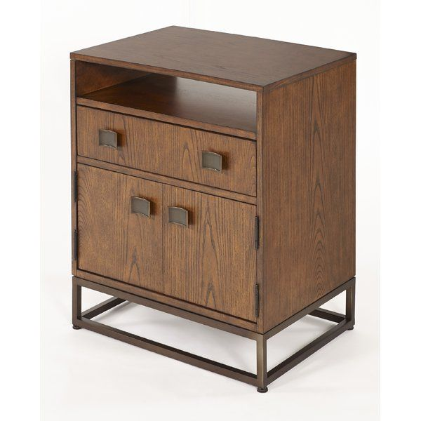 This retro style nightstand features ash veneers in a sienna finish supported by an antique gold finish metal base. Rectangular shaped Asian inspired drawer and door pulls along with a metal base are in an antique gold finish. There's storage galore with a top shelf, a top drawer, and a second shelf and locking drawer behind two doors. The top drawer is lined with felt for delicate items. Power and charging station along with underneath lighting operated by touch round out the modern…