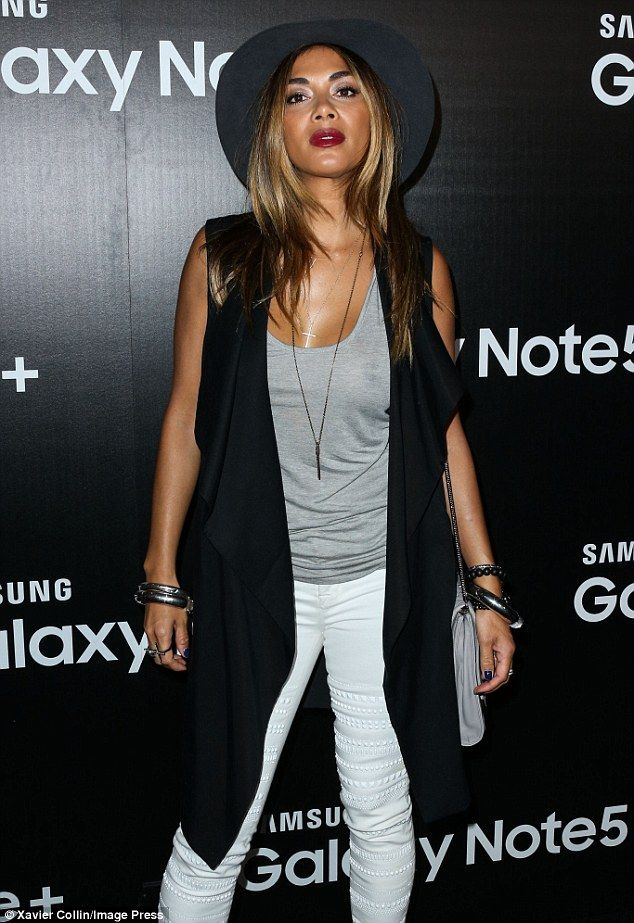 Daring to bare: Nicole Scherzinger stepped out not wearing a bra, exposing her nipple in a semi-sheer grey vest top as she attended a launch event in Los Angeles, California, on Wednesday night