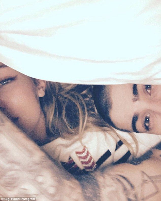 Be in the bed all day: Gigi Hadid and Zayn Malik seemingly recreated the lyrics of the pop hunk's hit single Pillowtalk as they cuddled up underneath the covers in her latest Instagram snap