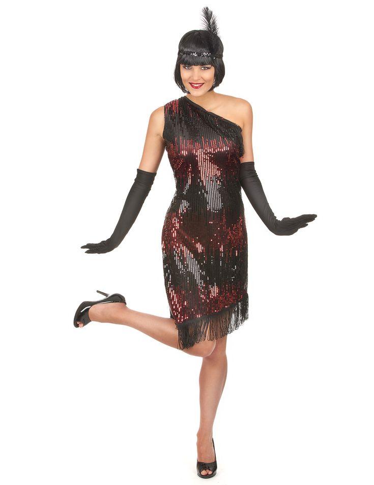 Disfraz de charlestón negro y rojo: Este disfraz de charlestón para mujer está compuesto por un vestido negro, una cinta y unos guantes largos (zapatos no incluidos). El vetsido asimétrico tiene lentejuelas negras...