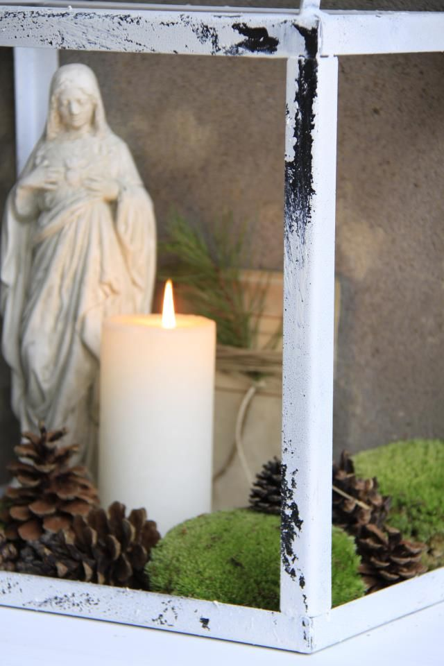 moss, pinecones, candle via Jeanne d'Arc Living magazine