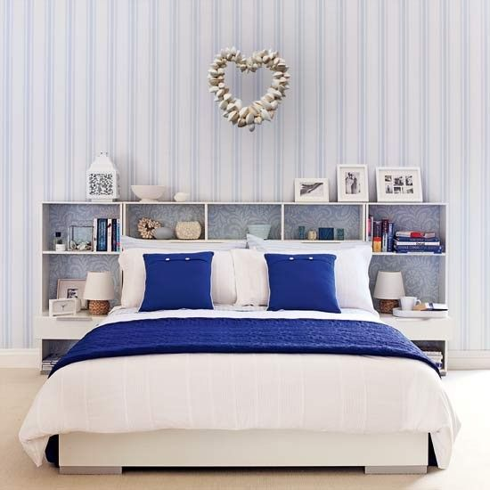 I like the idea of the white mat and white frames and the striped walpaper and seashell heart.