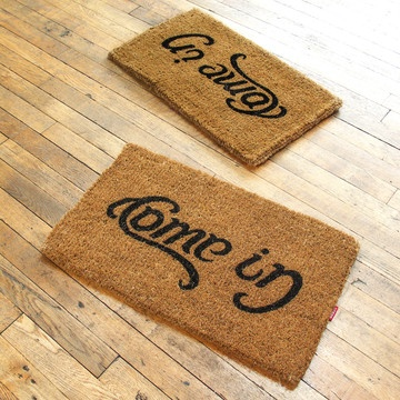 Mind-boggling reversible doormat (reads two different ways).
