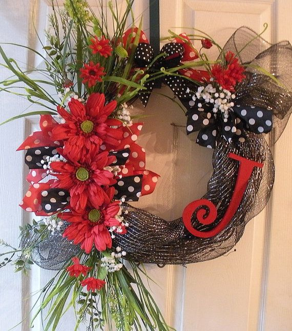 Initial grapevine wreath, they have some cute letters at Hobby Lobby for this...