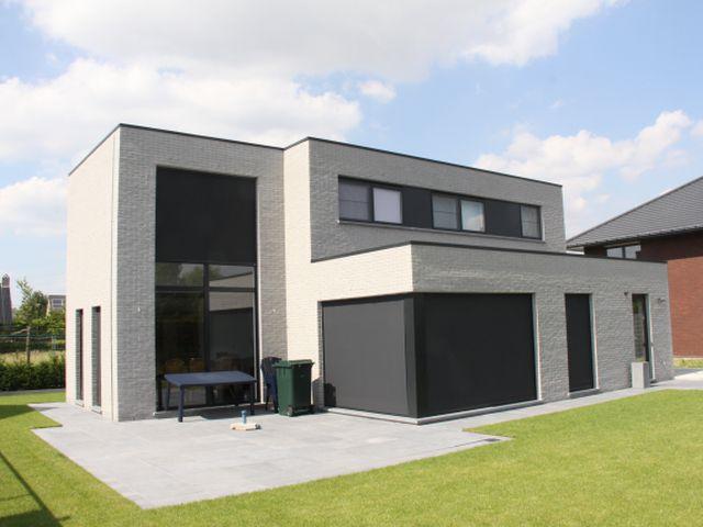Nieuwbouw modern strak achtergevel plat dak foto for Woningen moderne villa
