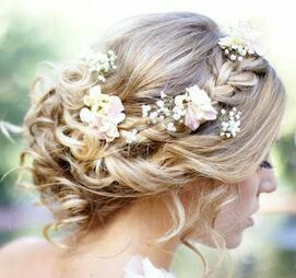 A braid and waves pulled back with flowers tucked in for added romance