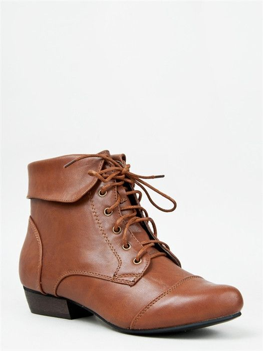- Rustic oxford booties feature a weathebeige wash and fold-over cuff that give off a perfect vintage vibe. - Lace-up boots come in leatherette with a lace-up closure to the vamp and double stitch det