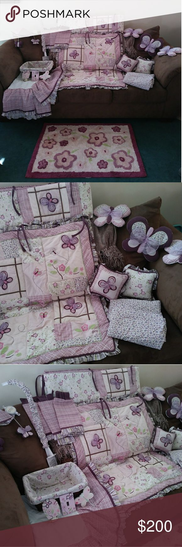 Baby girl butterfly crib bedding & accessories 16 piece bedroom/crib set. Comes with quilt (2) crib sheets, crib skirt, matching basket, (2) decorative pillows, (3) butterfly wall decorations, (3) window valances, small area rug, musical mobile, crib bumper, light switch cover & night light. Everything in perfect condition! Cucalo Other