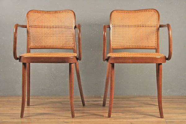 Here we have a a vintage pair of Thonet chairs. These chairs are being sold together as a pair. The bent wooden frames are in great shape and the caning is in place with no...