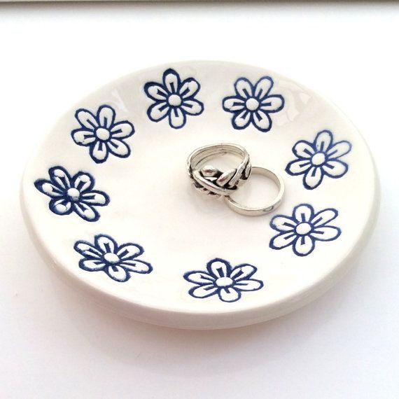 Flowers Dish Ceramic Ring Dish Blue  This handmade ceramic ring dish has been imprinted around the edge with a small indian wood block flower design and decorated with a cobalt blue glaze. It is then finished with a hardwearing clear glaze to make it a pretty and practical dish for the home. Its the ideal size (9cm/3.5 diameter) for use as a ring dish, soap dish or tealight holder. It would look great in any room of the house.  The ring dish is packaged in a white gift box, so you can s...