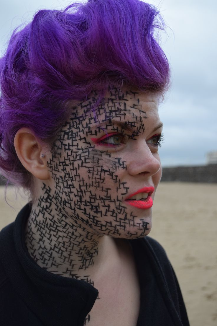 Close up of the makeup which I created for my Avant Garde assessment. I created a black line pattern on the face with fluorescent pink watercolour paint on the eyes and the lips.