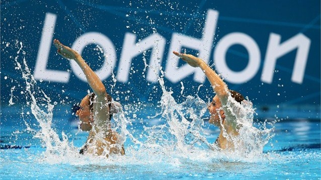 Natalia Ishchenko and Svetlana Romashina of Russia compete in the Women's Duets Synchronised Swimming Technical Routine on Day 9.