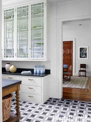 Butler's pantry cabinets with original glass doors are painted in Farrow  Ball's Estate Emulsion in Shaded White.