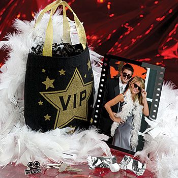 Hollywood themed bag, feather boa and party favors! What a fun gift for your bridesmaids at your bachleorette party!