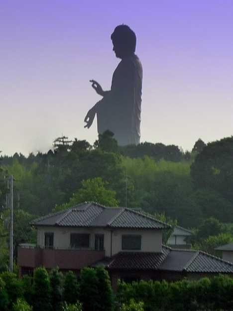 Yes, that's a real statue. Ushiku Daibutsu located in Japan's Ibaraki prefecture.