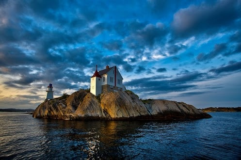 Ryvingen Lighthouse in Grimstad, Norway on a small island