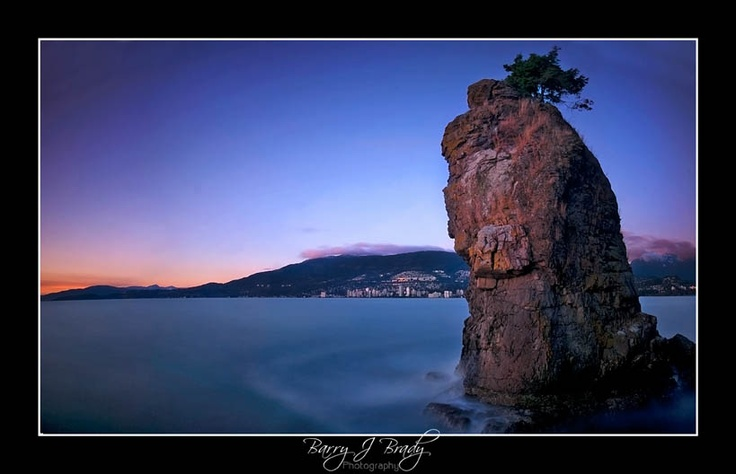Siwash Rock, a sentinel on the Seawall of Stanley Park