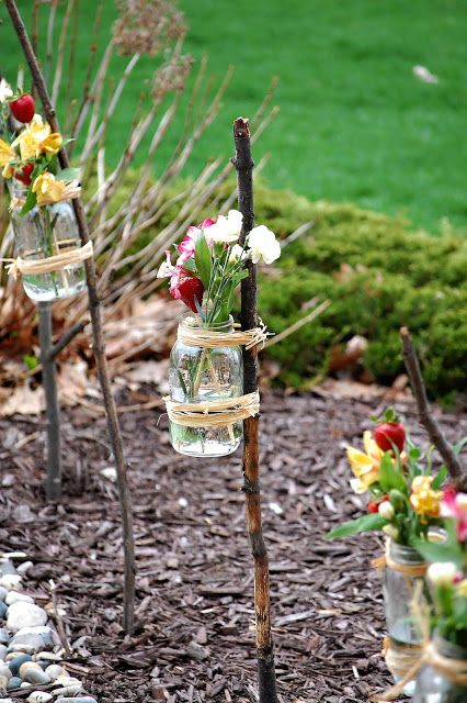 Tie a mason jar to a stick with raffia and fill with flowers from your garden. Great idea to do by my front and back doors. For The Love of Jars! Decorating with Jars Collection