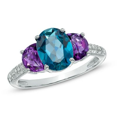 Oval London Blue Topaz, Amethyst and 1/10 CT. T.W. Diamond Three Stone Ring in Sterling Silver - Size 7