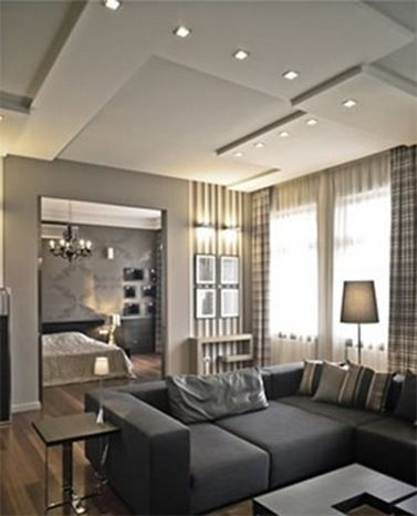 Contemporary Dropped Ceiling Treatment - This home from Budapest uses a contemporary  ceiling treatment by varying heights & geometric patterns.