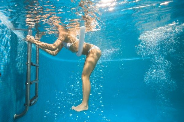 Holding pool ladder with both hands, elbows bent, place noodle under stomach and float with legs extended behind you, feet together. Engage abs to stabilize and lower legs toward pool bottom, so body forms a 90-degree angle (as shown). Return to start for one rep. Do 20 reps. works abs, hips, butt, legs