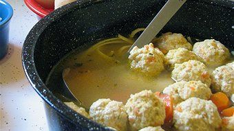 Meatball soup with crusty rolls