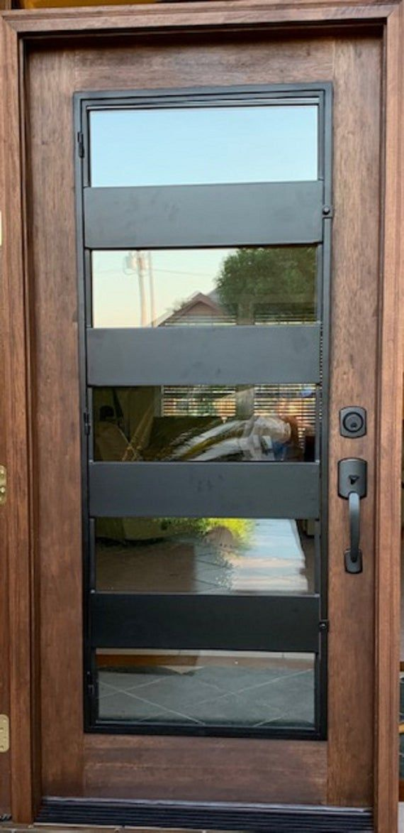 Modern Wood And Iron Entry Door Contemporary Door Minimalist Door Unique Modern Door Custom Modern Door Elegant Modern Door Front Door In 2021 Iron Entry Doors Modern Exterior Doors Modern Door