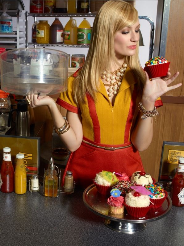 Sweet Tooth Caroline (Beth Behrs) gets a closer look at this candy-covered cupcake. Photo : Yu Tsai/CBS ©2011 CBS Broadcasting Inc. All Rights Reserved.