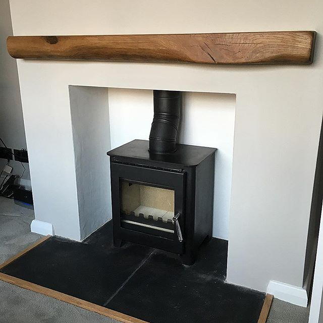 Well that's the fireplace done, little multi fuel stove, reclaimed oak beam, lime rendering, slate hearth and a splash of Farrow and Ball Cornfourth White with a thick, cosy grey carpet. #carpet #fire #fireplace #mantle #mantlepiece #woodburningstove #woodburner #renovations #karndean #renovation #renovationjourney #renovationproject #builder #firsttimebuyer #house #home #1960s #interior #extension #farrowandball #grey #oak #beam #lounge #livingroom #slate #hearth #
