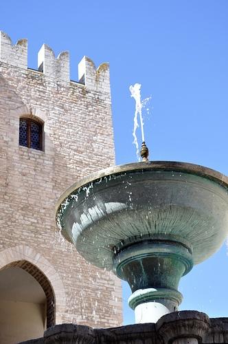 The Sturinalto fountain and the Palazzo del Podestà (medieval civil building) - 13th Century - Fabriano (Marche - Italy)