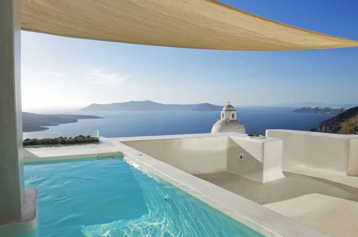 The two-storey residence is adjusted to the old and densely built area of Fira in such a way so as to face the view of the volcano in front of it.