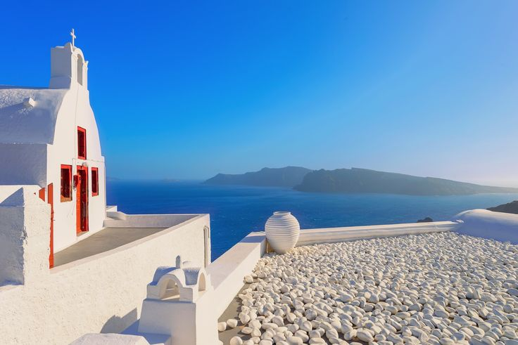 Small chapel by the Cycladic blue sea