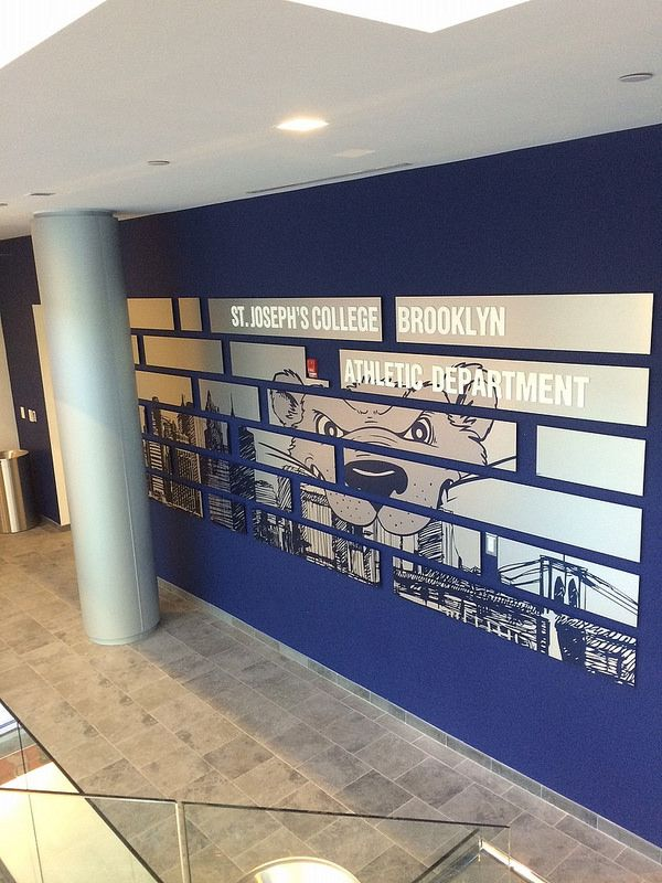 This Dibond Wall cutout was used to make a plain wall into a great piece of school branding. #dibond #school #signage