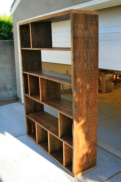 Bookcase ideas. This could work but several of the cubes would need a basket or tote. visual relaxing that way.