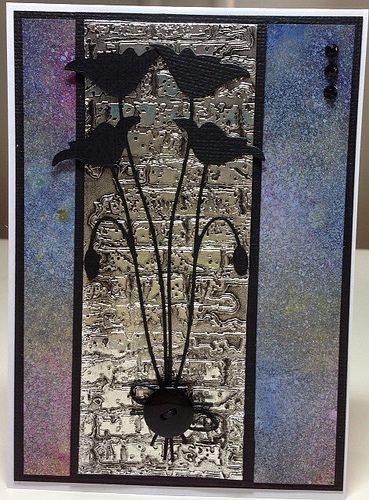 handmade card for challenge: P*skarteluhaaste # 197 - Bingo, musta - sininen - harmaa ... luv the antiqued metal panen with broken brick embossing folder texture ... deilicate die cut Memory Box flowers in black ... metallic background  sprayed in soft colors ... super artsy delight!