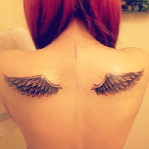 Wing tattoo on the back