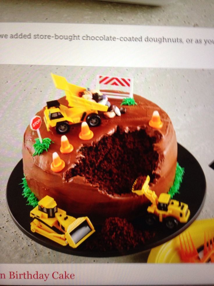 Construction site birthday cake.   E likes this one the best now.  a choc cake that looks like dirt/land. We'd use our excavator to dig a hole in it. Have candy corn around the edge as cones.  maybe make a sign w/ 5 miles per hour on it?   Make foil letters for the side?