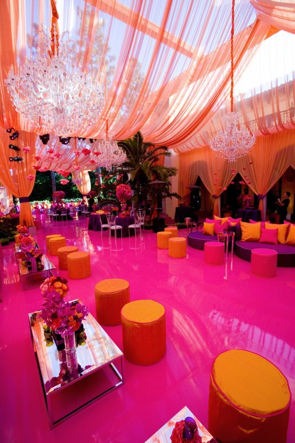 I don't even know where to begin.. The ceiling draping treatment is so luxe, and the fun event colors make for well matched colorful event!
