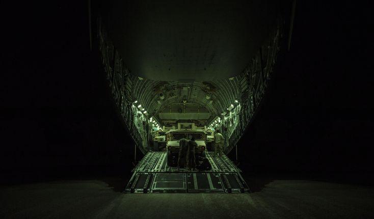 U.S. Air Force C-17 Globemaster III aircrew from the 816th Expeditionary Airlift Squadron unloads high-mobility multipurpose vehicles during combat airlift operations at an undisclosed location, Nov. 11, 2017. The C-17 is capable of rapid strategic delivery of troops and cargo to bases throughout the U.S. Central Command area of responsibility. The aircraft can be outfitted to perform tactical airlift, airdrop, and aeromedical evacuation as missions require.