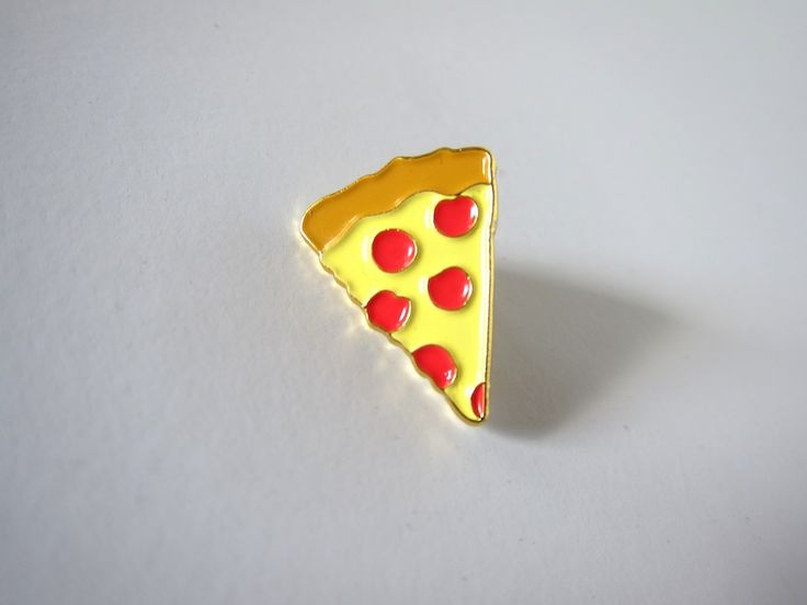 "Step your emoji game in to the real world with our pizza emoji lapel pin. Wear it on your jacket or bag while you are enjoying a fine slice.0.8"" die cast enamel pin with rubber clutch on rear."