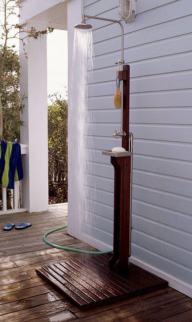 We need this at our house! Love the outdoor shower with simple fixtures and drainage. Attach an electric heater and we are good to go!