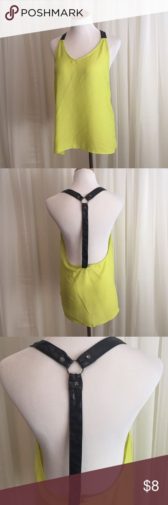 Neon yellow top with faux leather racer back How adorable is this with a little lace bralette under? The racer back is faux leather and the material is a soft sheer neon yellow. Joyce Tops Tank Tops
