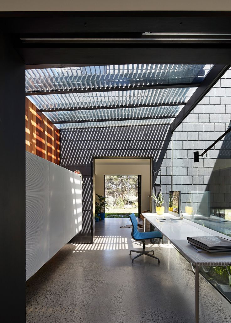 Slate shingles are arranged in various patterns across the house-shaped blocks that make up this multi-generational residence in the Melbourne