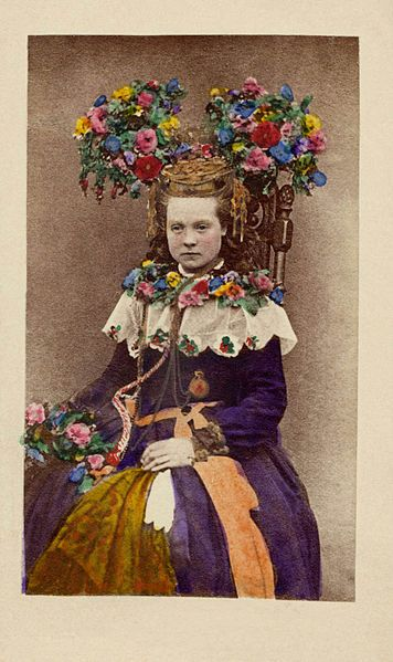 A bride from Hälsingland, Sweden. A hand-coloured photograph, between 1870 and 1899.